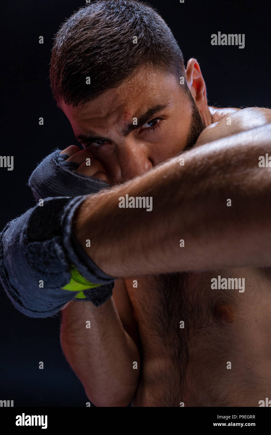 Double arm block. Boxing trainer showing defensive techniques. Combat sport, fight club. - Stock Image