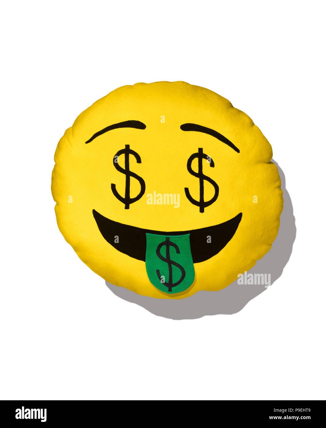 A colourful shot of the dollar sign Emoji cushion. - Stock Image