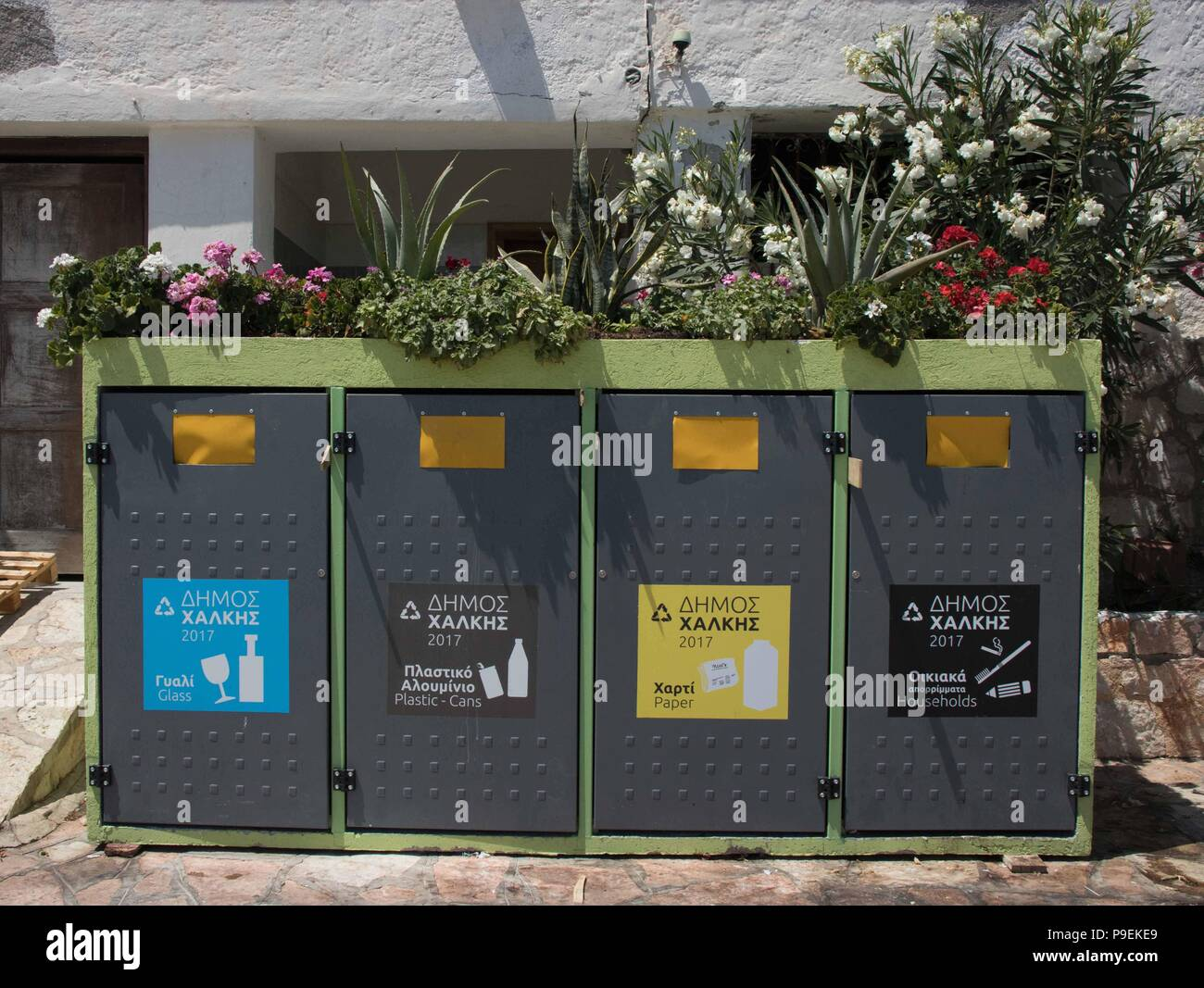 At last, recycling comes to Halki, near Rhodes, Dodecanese, Greece! - Stock Image