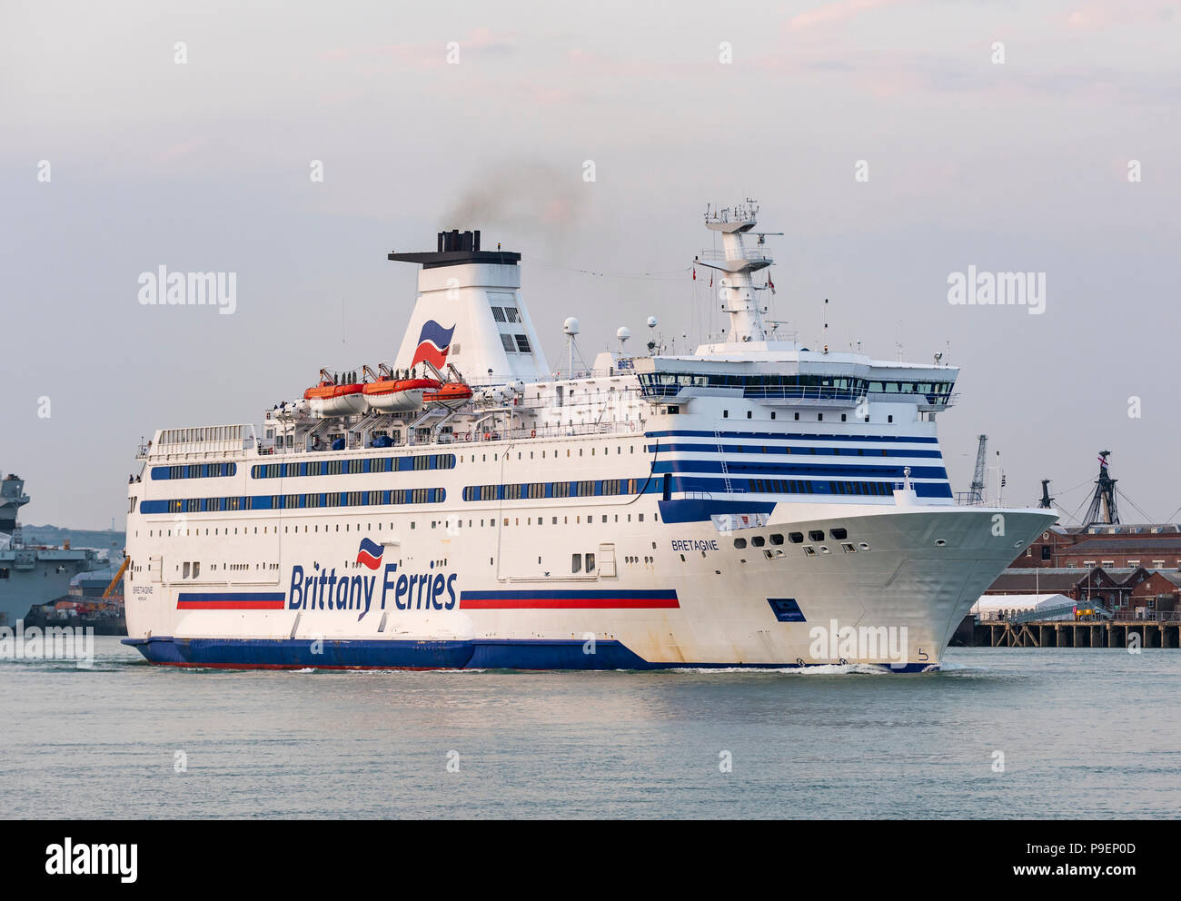 Add new tags   Brittany Ferries ship Bretagne travelling out of Portsmouth Harbour towards the Solent Strait in Portsmouth, Hampshire, England, UK. - Stock Image