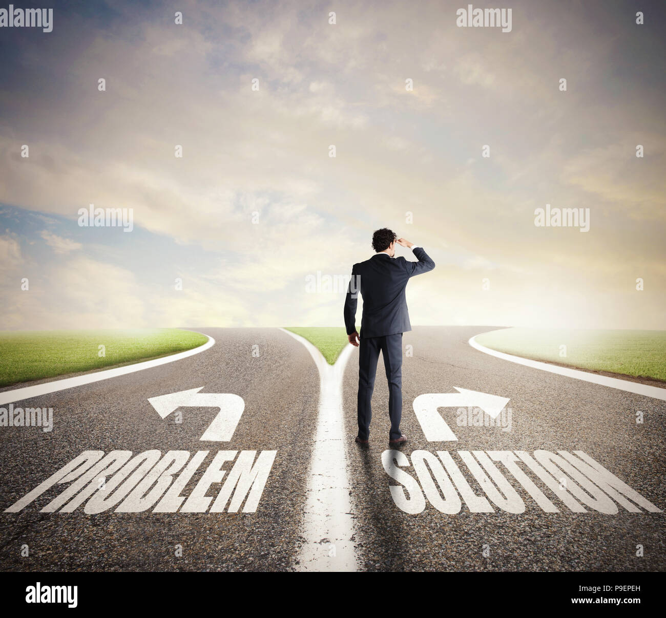 Businessman at a crossroads. He chooses the correct way. Concept of decision in business - Stock Image