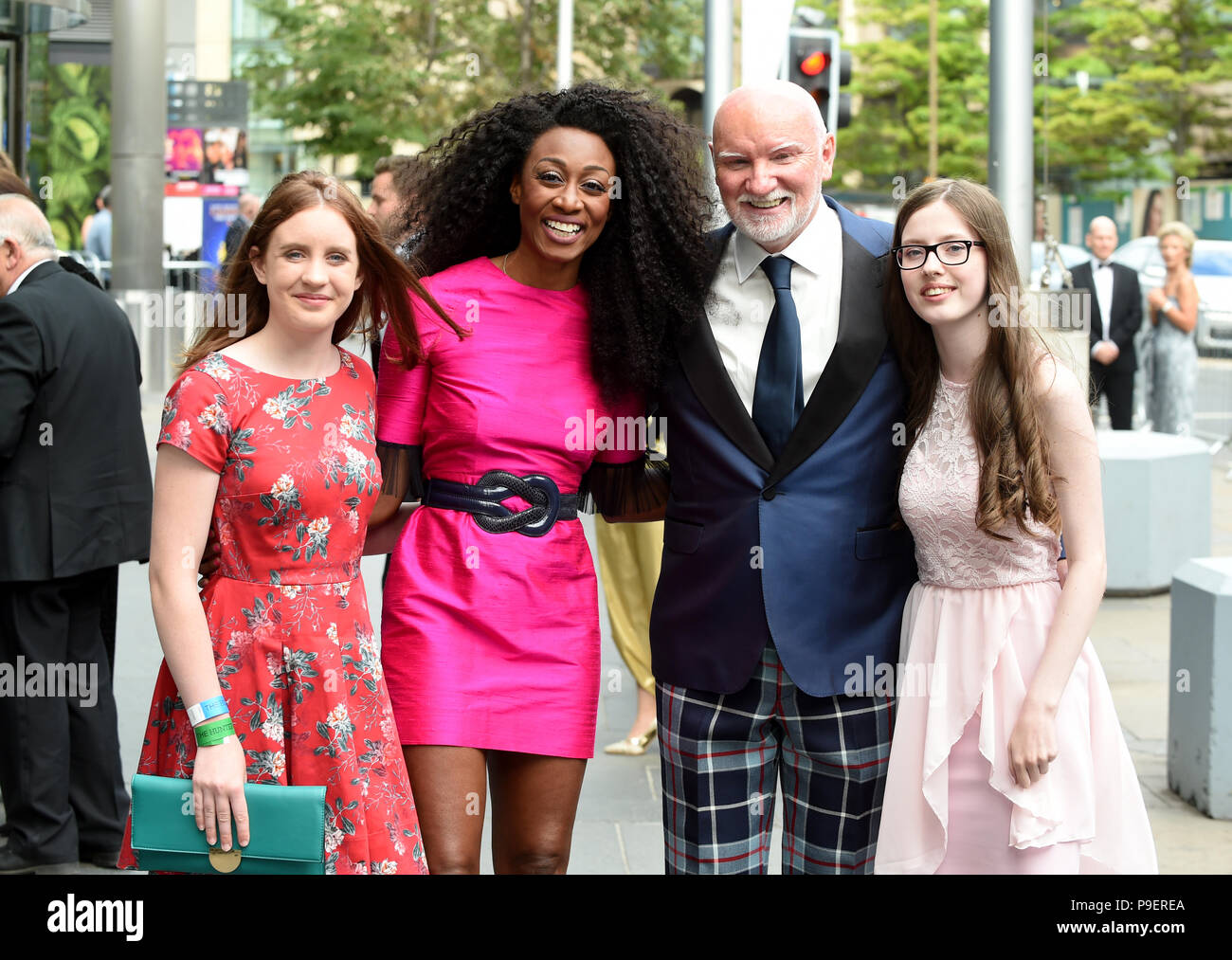 Sir Tom Hunter and singer Beverley Knight meet competition winners Melissa Croft (S3 Mearns Castle High School) and Cerys Gough (14 year old from Langholm Academy) as they arrive at the Edinburgh International Conference centre (EICC) to attend a fundraising dinner organised by The Hunter Foundation (THF) where former US first lady Michelle Obama is expected to speak about her time at the White House. - Stock Image