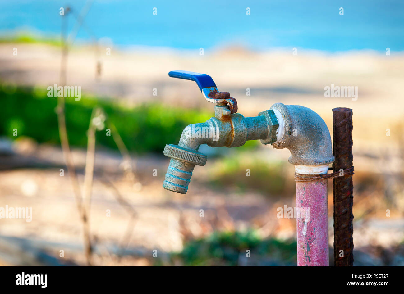 Garden water tap outside. Close-up. - Stock Image