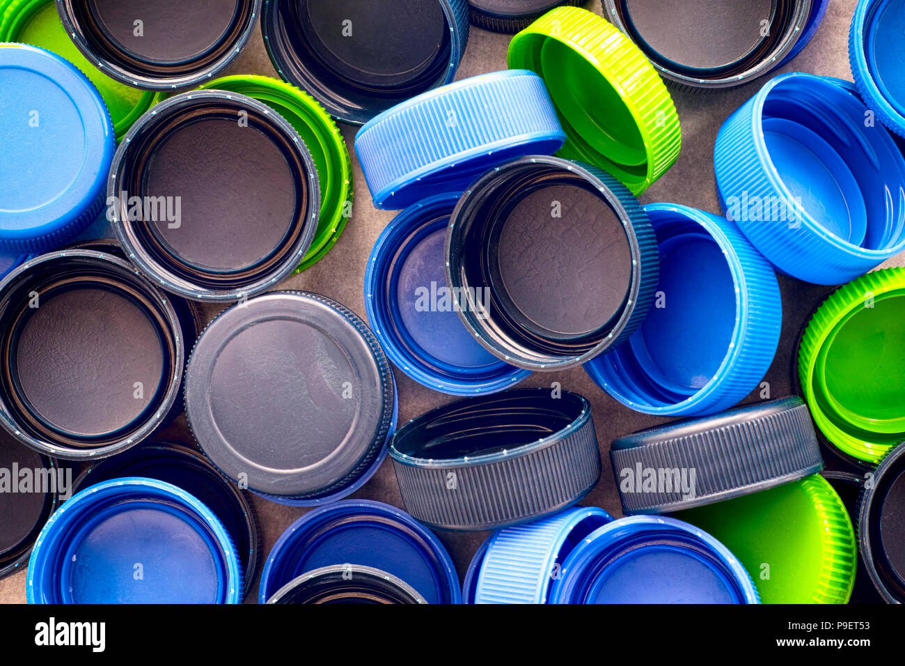 Plastic caps on black background. Close-up. - Stock Image