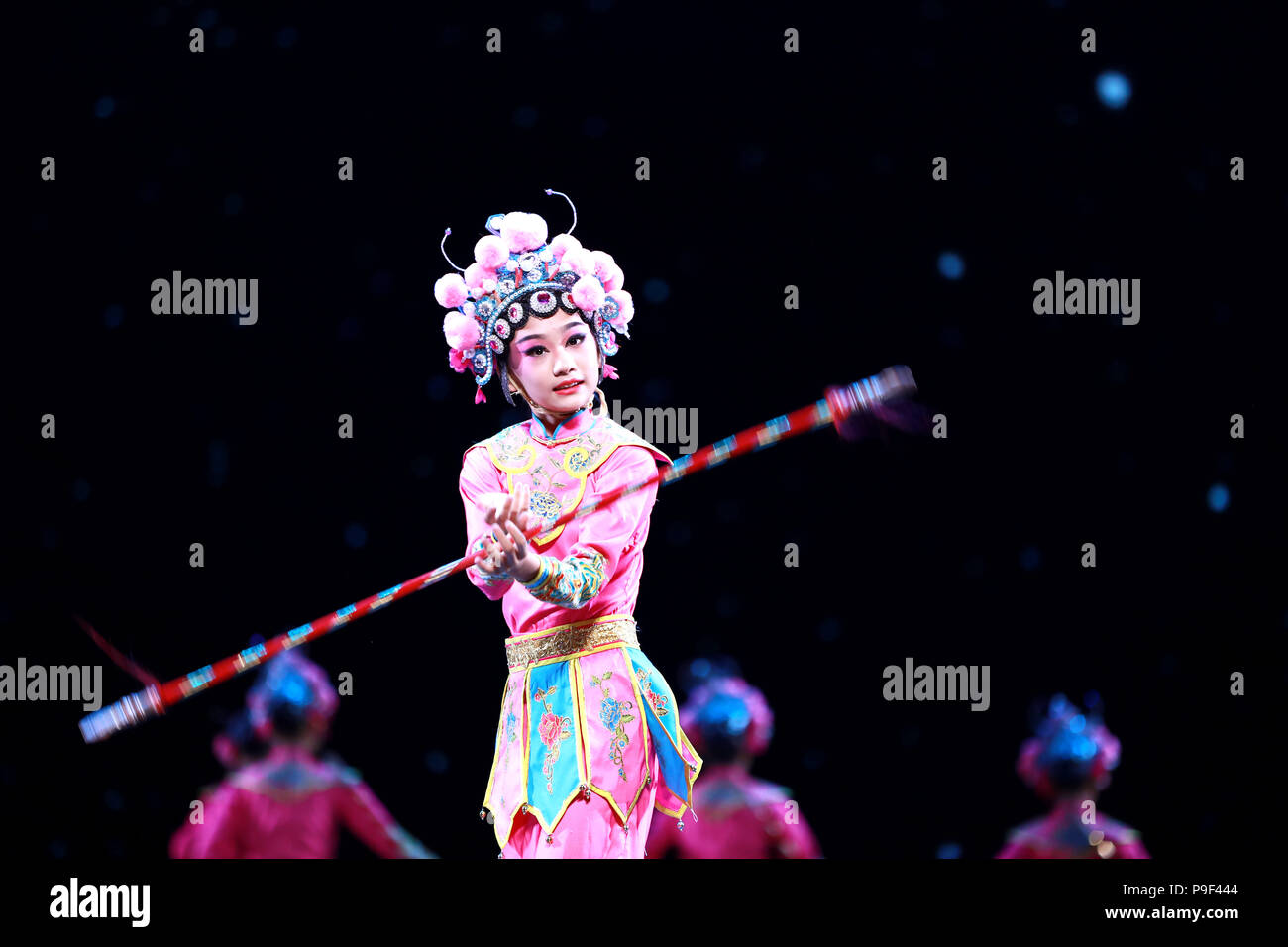 (180718) --BEIJING, July 18, 2018 (Xinhua) -- Child actors dance during a dance exhibition at Tianqiao Performing Arts Center in Beijing, capital of China, July 17, 2018. The dance exhibition co-hosted by China Federation of Literary and Art Circles and Chinese Dancers Association was held here from July 17 to 18. (Xinhua/Pan Xu) (hxy) - Stock Image