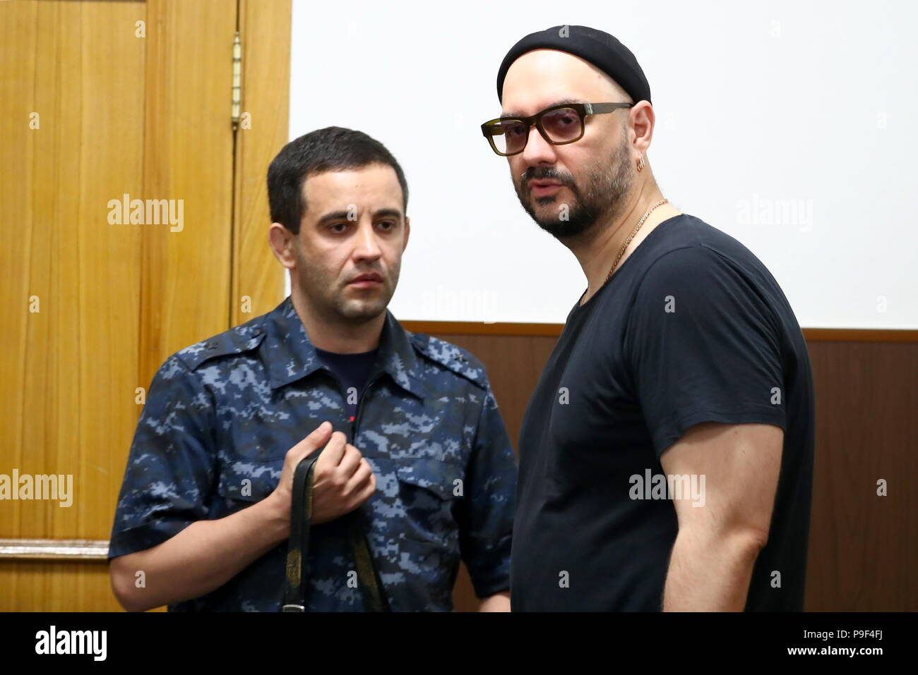 MOSCOW, RUSSIA - JULY 18, 2018: The artisitc director of Gogol Center, stage director Kirill Serebrennikov (R) arrives for a hearing into an application for a warrant for his further detention, at Moscow's Basmanny District Court; Kirill Serebrennikov was detained in August 2017, he is charged with embezzling 133m roubles of budget funds allocated in 2011-2014 for Sedmaya Studiya (Seventh Studio) theatre collective; the criminal investigation into the alleged fraud was launched by the Investigative Committee of Russia in 2015. Anton Novoderezhkin/TASS - Stock Image