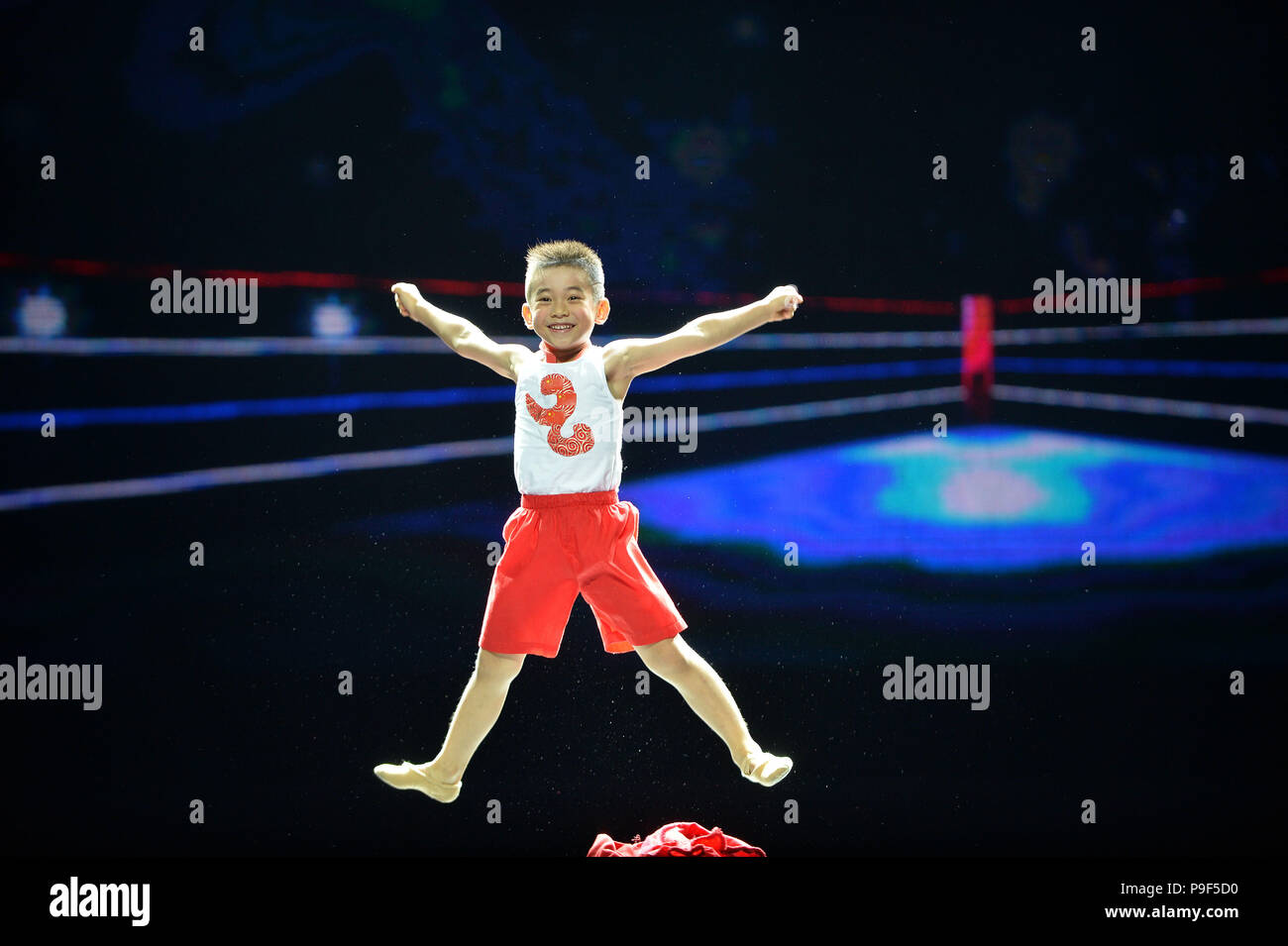 Beijing, China. 17th July, 2018. A little boy performs during a dance exhibition at Tianqiao Performing Arts Center in Beijing, capital of China, July 17, 2018. The dance exhibition, co-hosted by China Federation of Literary and Art Circles and Chinese Dancers Association, was held from July 17 to 18. Credit: Xiao Xiao/Xinhua/Alamy Live News - Stock Image