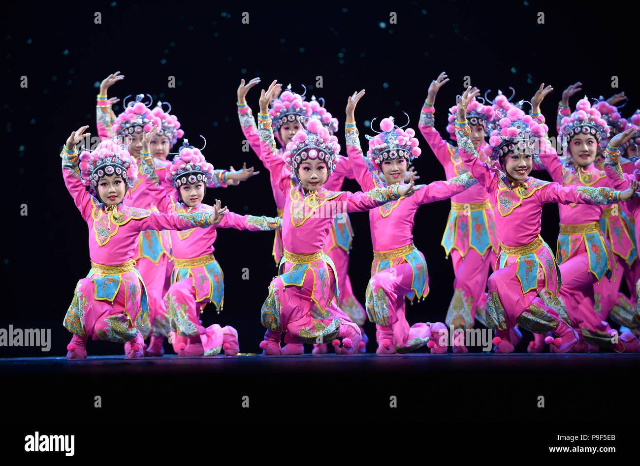 Beijing, China. 17th July, 2018. Children perform during a dance exhibition at Tianqiao Performing Arts Center in Beijing, capital of China, July 17, 2018. The dance exhibition, co-hosted by China Federation of Literary and Art Circles and Chinese Dancers Association, was held from July 17 to 18. Credit: Xiao Xiao/Xinhua/Alamy Live News - Stock Image