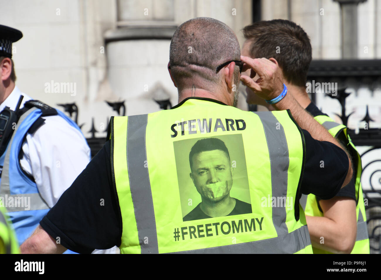London, UK. 18th July 2018. Tommy Robinson is a formal far-rights EDL leader the supporter of Tommy outside the Royal Courts of Justice to #FreeTommy. Tommy has been send to jail for 13 months of breaking contempt of court laws at the Lord Justice Leveson hearing Tommy's appeal on 18th July 2018 in London, UK. Credit: Picture Capital/Alamy Live News - Stock Image