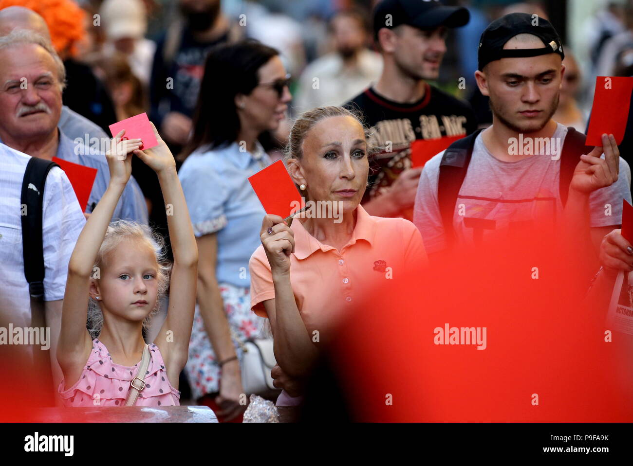 St Petersburg, Russia. 18th July, 2018. ST PETERSBURG, RUSSIA - JULY 18, 2018: People take part in St Petersburg's Malaya Sadovaya Street rally against a Russian government proposal to raise the retirement age from 60 to 65 for men, and from 55 to 63 for women within the next two decades. Peter Kovalev/TASS Credit: ITAR-TASS News Agency/Alamy Live News - Stock Image