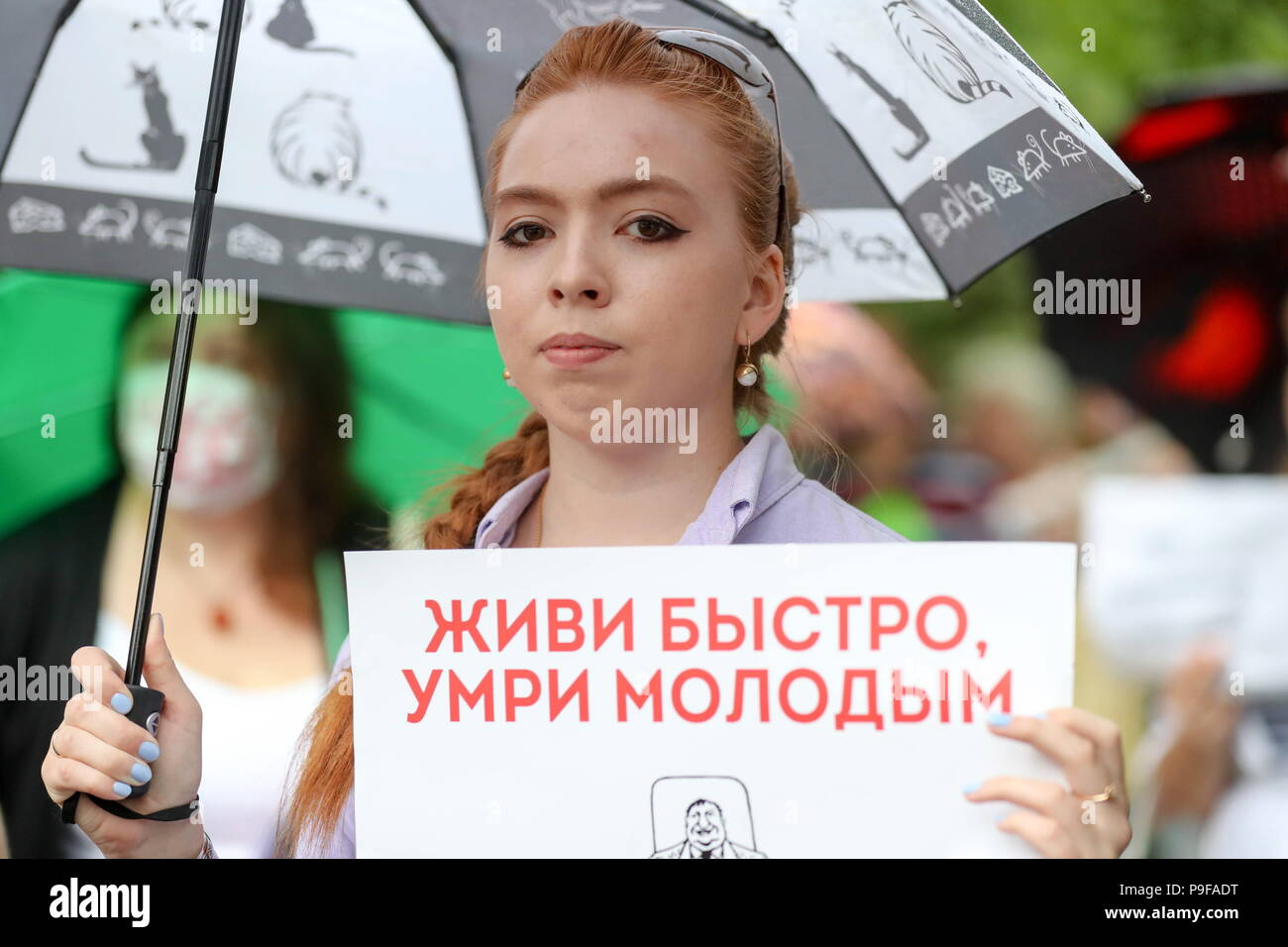 Moscow, Russia. 18th July, 2018. MOSCOW, RUSSIA - JULY 18, 2018: A young woman takes part in Moscow's Sokolniki Hyde Park rally against a Russian government proposal to raise the retirement age from 60 to 65 for men, and from 55 to 63 for women within the next two decades. Sergei Savostyanov/TASS Credit: ITAR-TASS News Agency/Alamy Live News - Stock Image