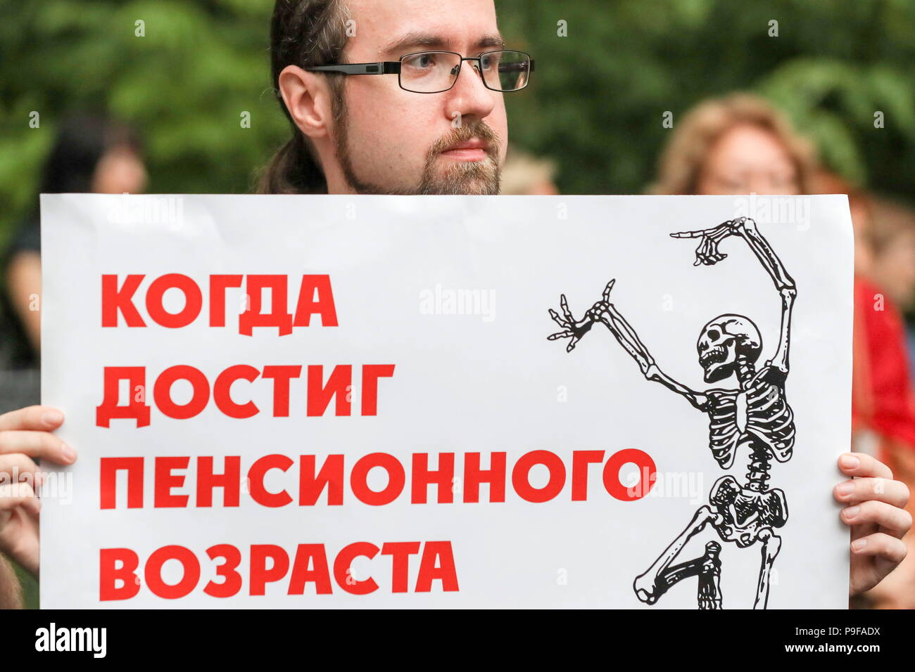 Moscow, Russia. 18th July, 2018. MOSCOW, RUSSIA - JULY 18, 2018: A young man takes part in Moscow's Sokolniki Hyde Park rally against a Russian government proposal to raise the retirement age from 60 to 65 for men, and from 55 to 63 for women within the next two decades. Sergei Savostyanov/TASS Credit: ITAR-TASS News Agency/Alamy Live News - Stock Image