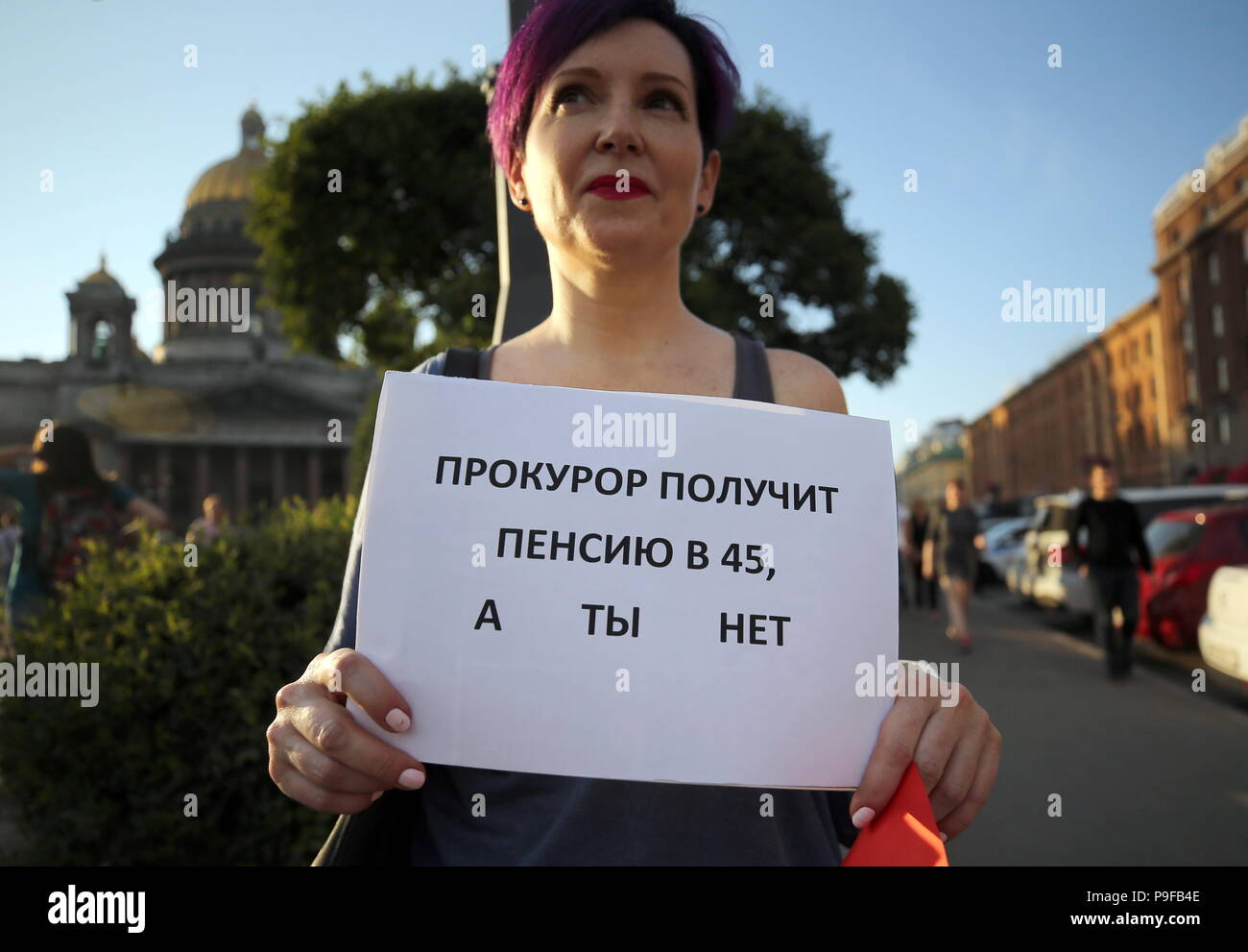 St Petersburg, Russia. 18th July, 2018. ST PETERSBURG, RUSSIA - JULY 18, 2018: A woman takes part in an unauthorized St Petersburg rally against a Russian government proposal to raise the retirement age from 60 to 65 for men, and from 55 to 63 for women within the next two decades. Peter Kovalev/TASS Credit: ITAR-TASS News Agency/Alamy Live News - Stock Image