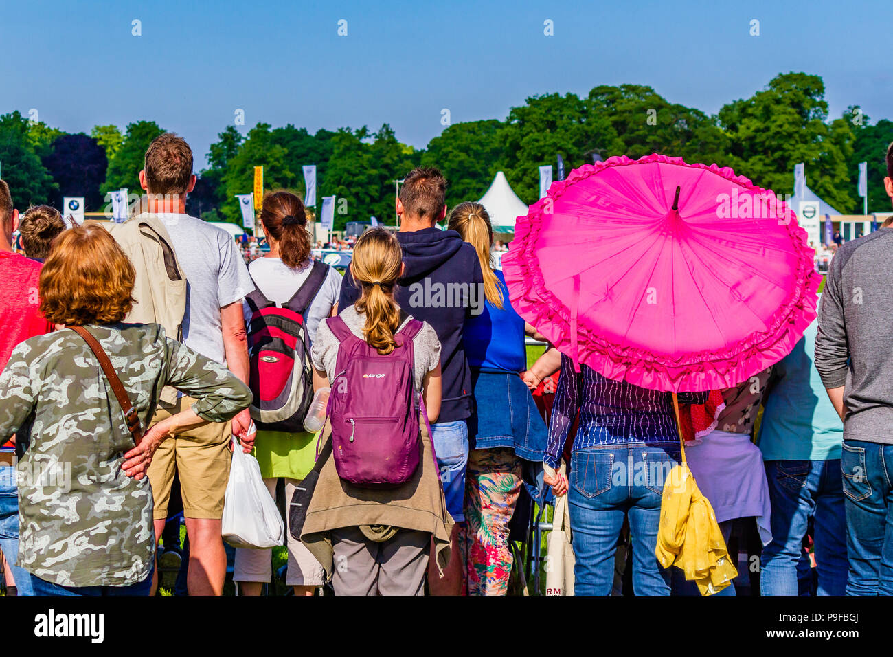 Behind summery crowd watching the arena at the Northumberland County Show, Stocksfield, Northumberland, UK. - Stock Image