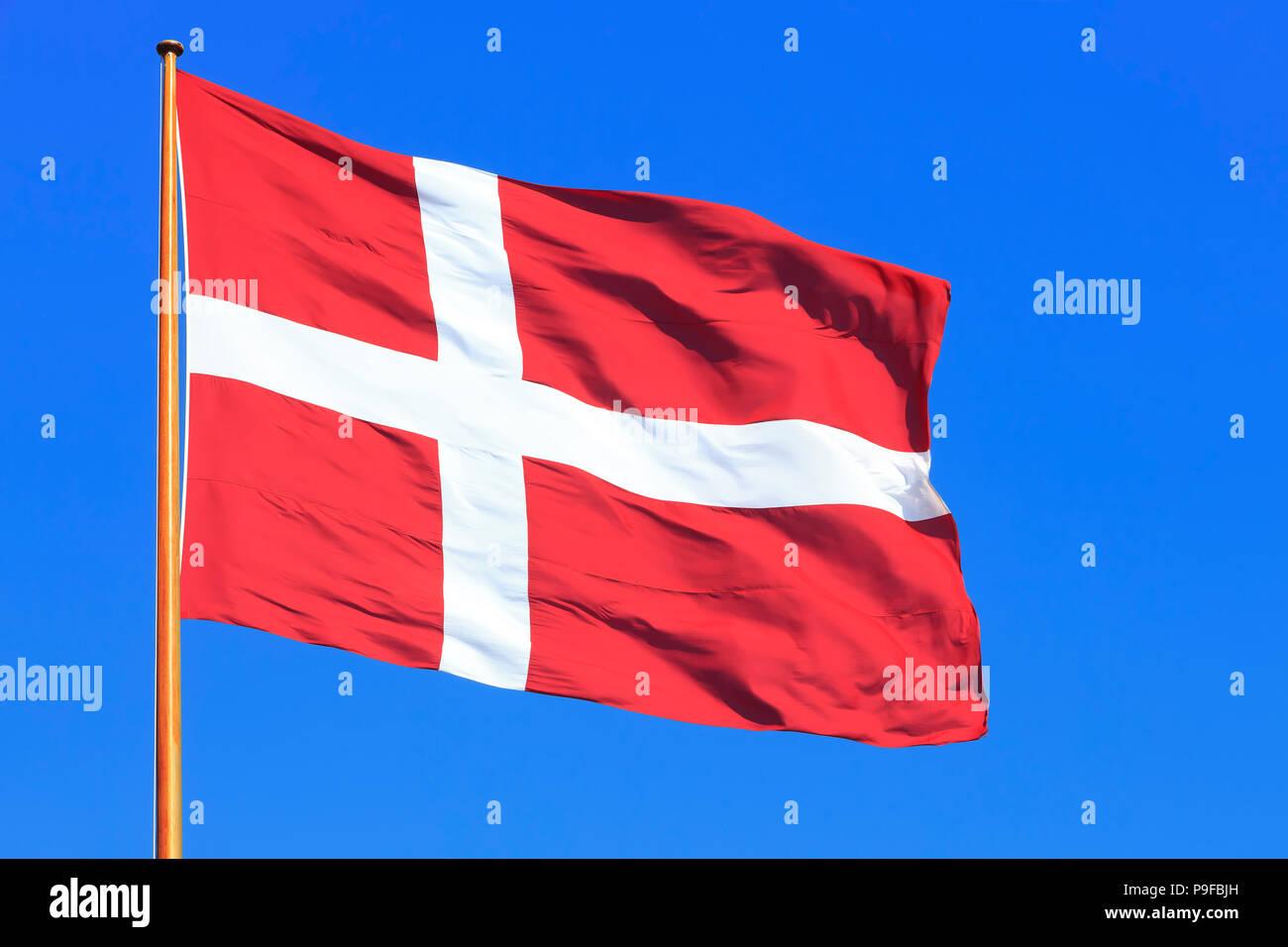 The national flag of Denmark (Dannebrog), flying high over Copenhagen, Denmark - Stock Image