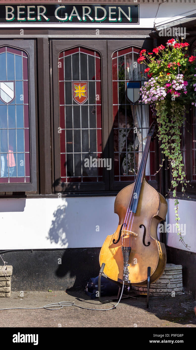 Double Bass left alone in the Beer Garden Stock Photo