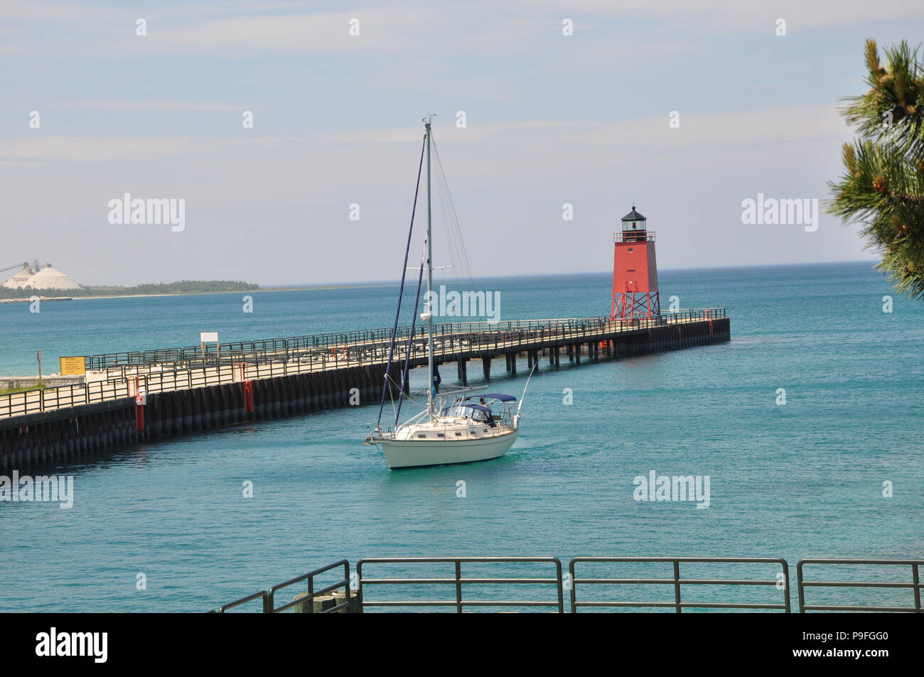Charlevoix South Pier Lighthouse in Charlevoix Michigan at the Island Lake Outlet (Pine River) channel to Lake Michigan. - Stock Image