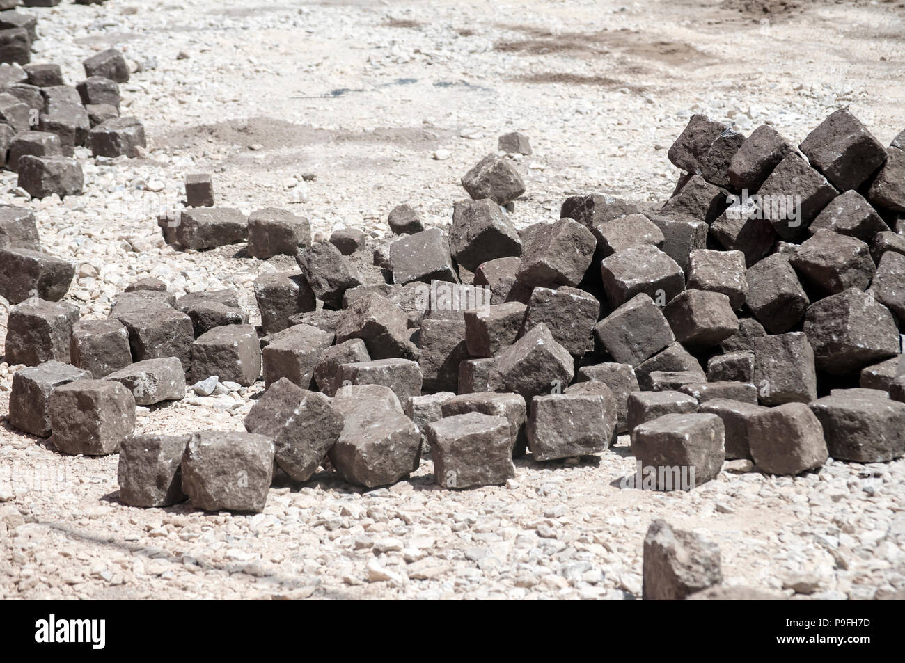 Construction work on paving of old city street closeup - Stock Image