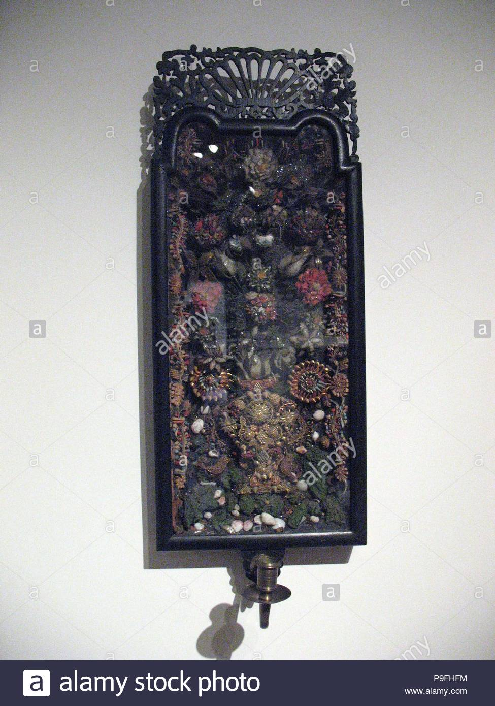 Quillwork Sconce, 1720–40, Possibly made in Redding, Connecticut, United States, American, Paper, shells, wire, glass, 28 3/4 x 10 7/8 in. (73 x 27.6 cm), Natural Substances, Possibly Ruth Read, A fragile form of handiwork, quillwork consists of narrow strips of paper rolled into tiny scrolls and glued, one against the other, within a shadow-box frame to form a design. In this case, sconces for candles were attached to the front of each frame, and the glittering mica-covered quillwork magnified and reflected the candlelight. - Stock Image