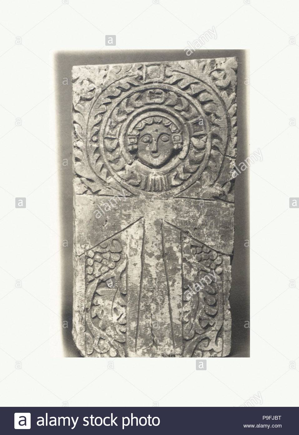 Funerary Stele With Ankh Looped Cross Featuring A Human Face At