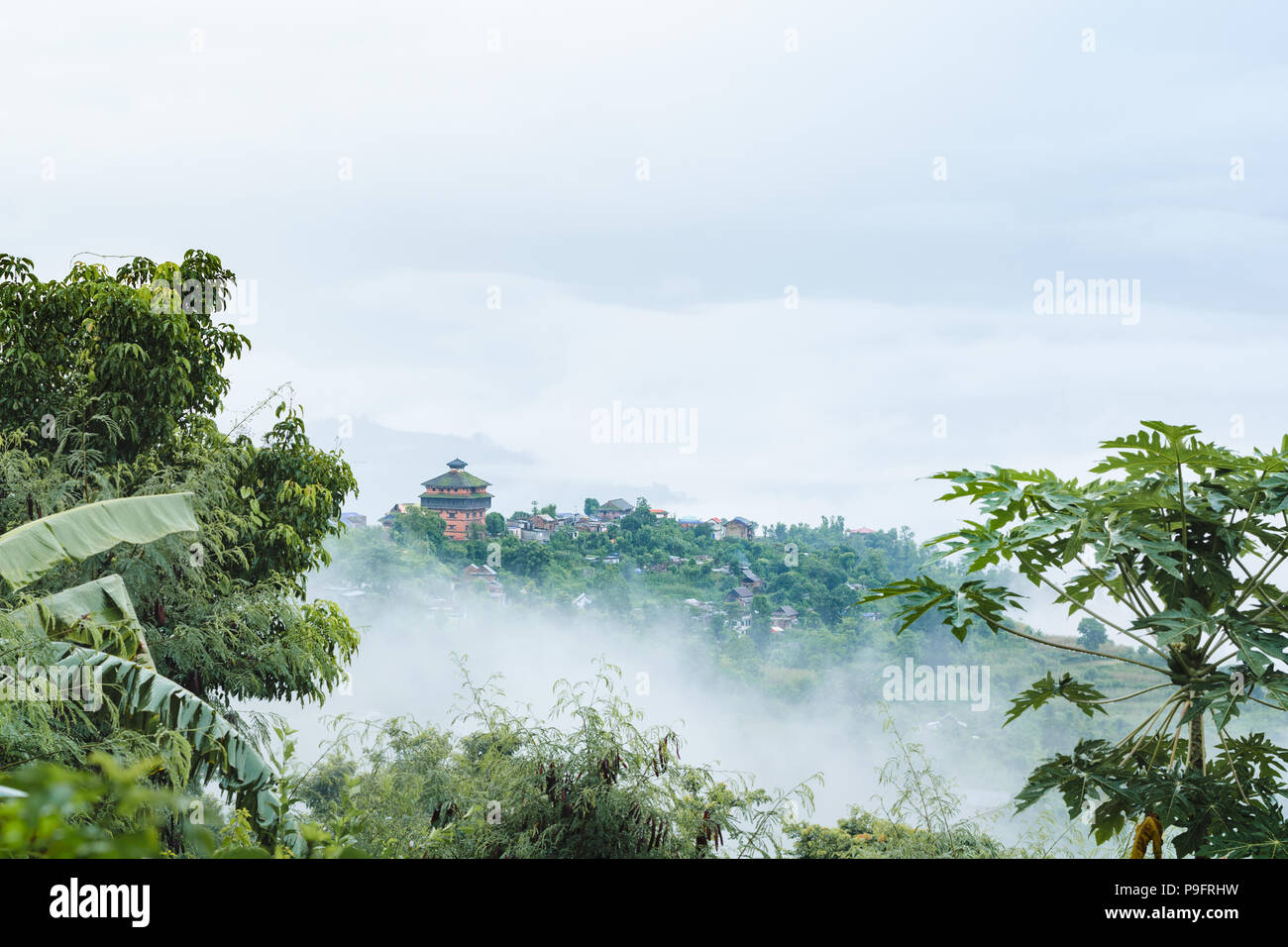 Nuwakot ancient castle tower appears in the morning haze from a hilltop near Nuwakot village, Nepal. - Stock Image