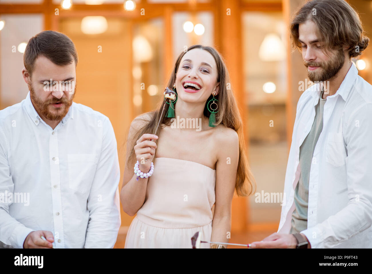 Friends having fun on the backyard of the house outdoors - Stock Image