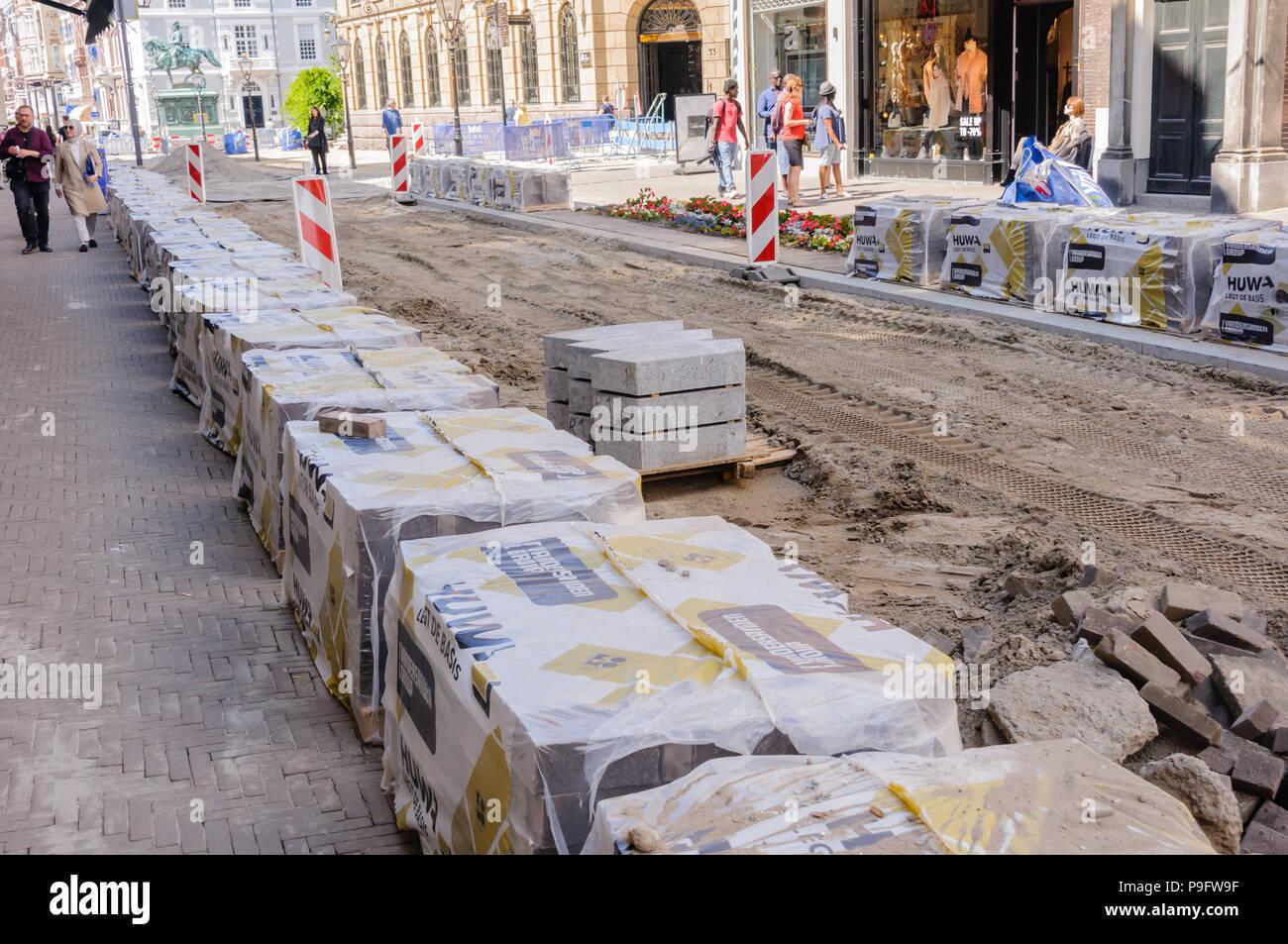 Roadworks underway in a European city. - Stock Image