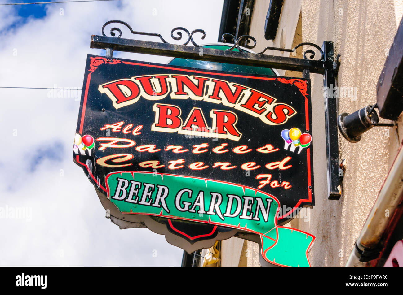 Sign outside a pub in Ireland advertising parties catered for and that it has a beer garden. - Stock Image