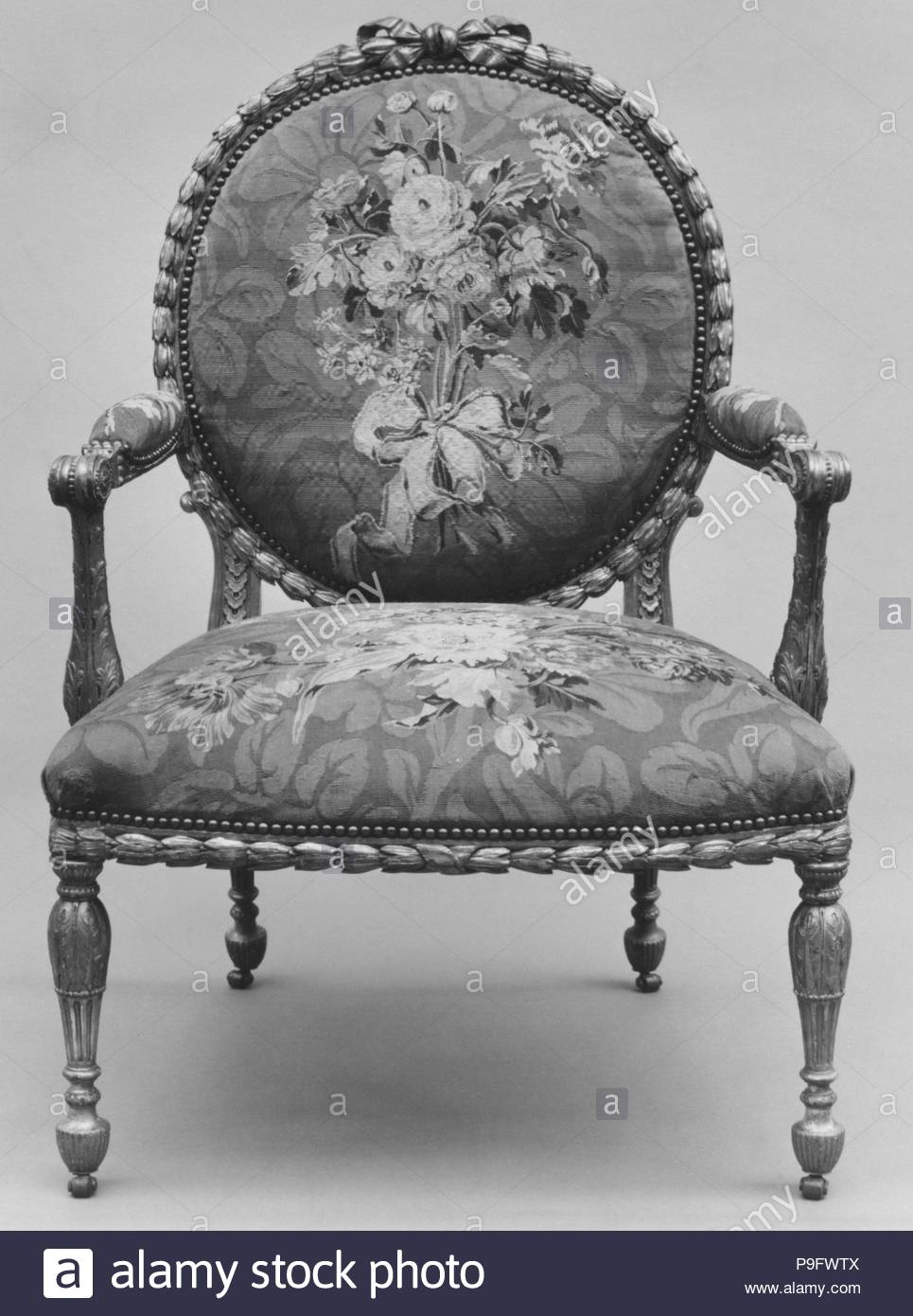 Armchair (one of a set of six), 1769–71, British and French, Gilded fruitwood; wool and silk (22-24 warps per inch, 9-10 per centimeter), 41 3/4 × 28 1/2 × 27 in. (106 × 72.4 × 68.6 cm), Woodwork-Furniture, John Mayhew (British, 1736–1811), and William Ince (British, active ca. 1758/59–1794, died 1804), Workshop of Jacques Neilson (French, 1714–1788). - Stock Image