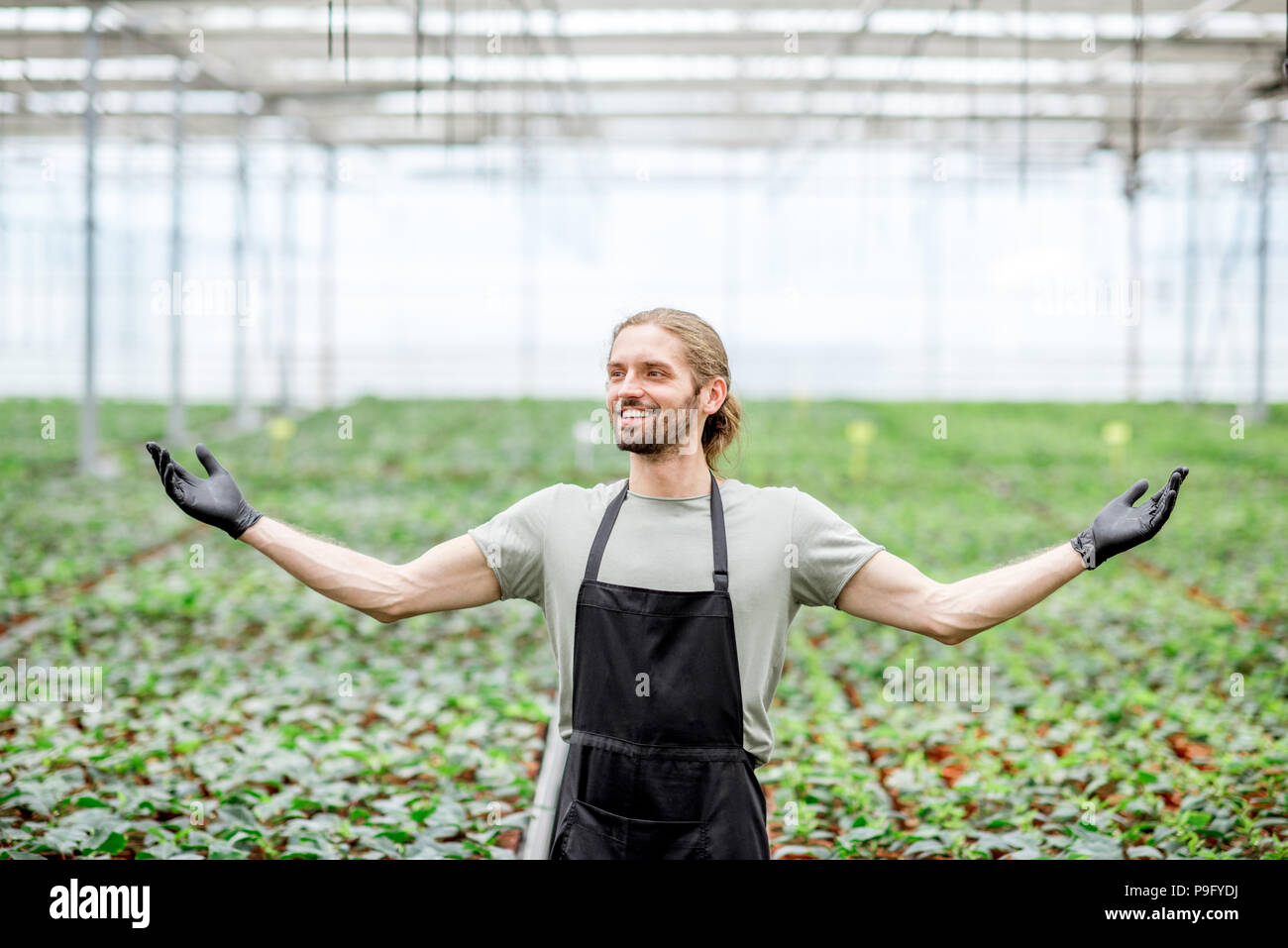 Happy owner of plant production - Stock Image