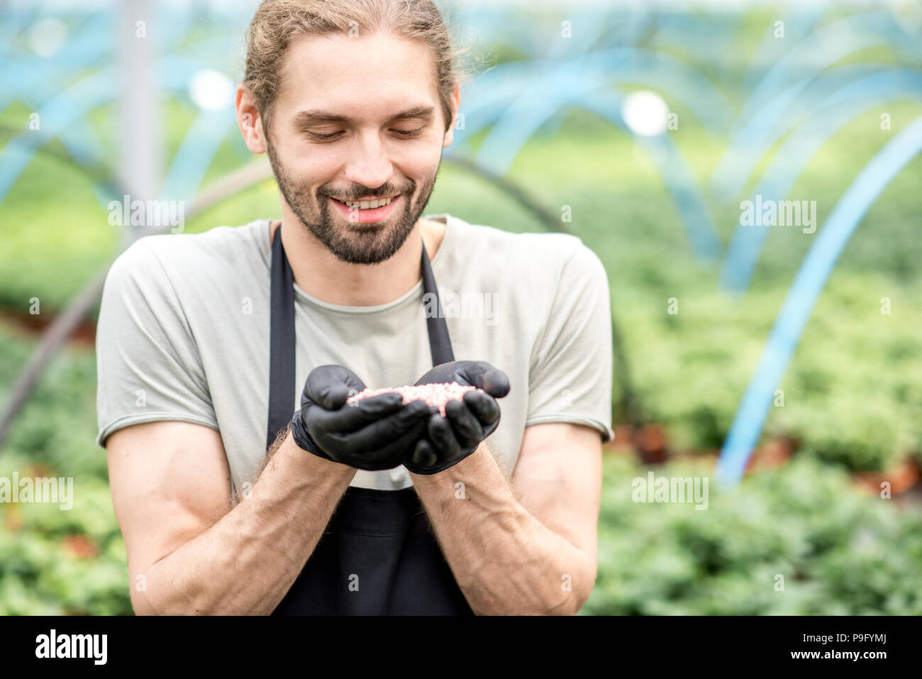 Farmer with mineral fertilizers - Stock Image