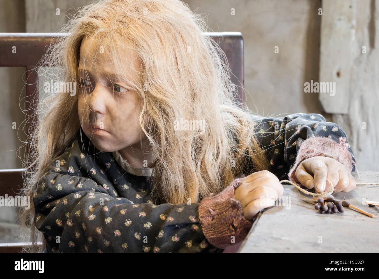 Medieval poor young girl in open air museum Den Gamle By in Aarhus - Stock Image