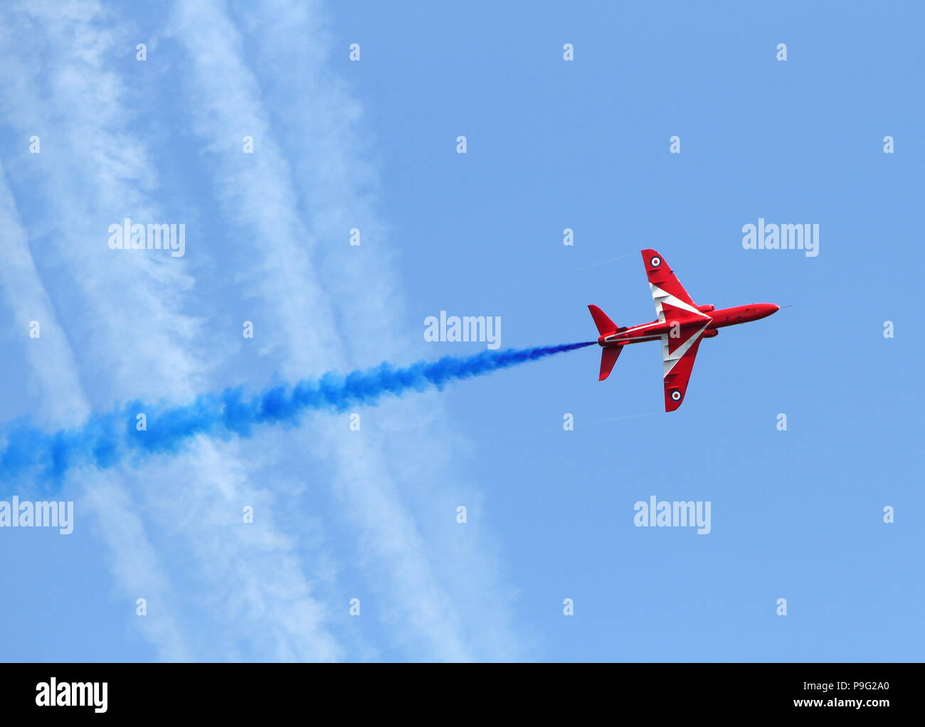 Torbay Airshow, Devon, England: The RAF Red Arrows display team breaks formation as it ascends - Stock Image