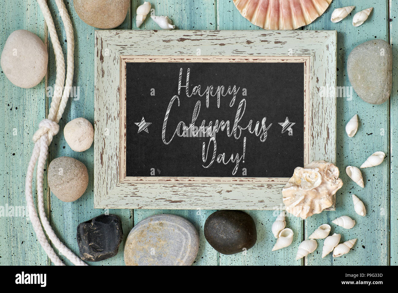 """Blackboard With Maritime Decorations on light turquoise wood, text """"Happy Columbus day"""" Stock Photo"""