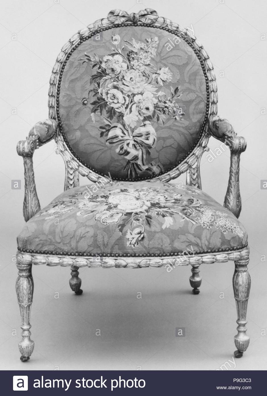 Armchair (one of a set of six), 1769–71, British and French, Gilded fruitwood; wool and silk (22-24 warps per inch, 9-10 per centimeter), 41 1/2 × 28 × 29 in. (105.4 × 71.1 × 73.7 cm), Woodwork-Furniture, John Mayhew (British, 1736–1811), and William Ince (British, active ca. 1758/59–1794, died 1804), Workshop of Jacques Neilson (French, 1714–1788). - Stock Image