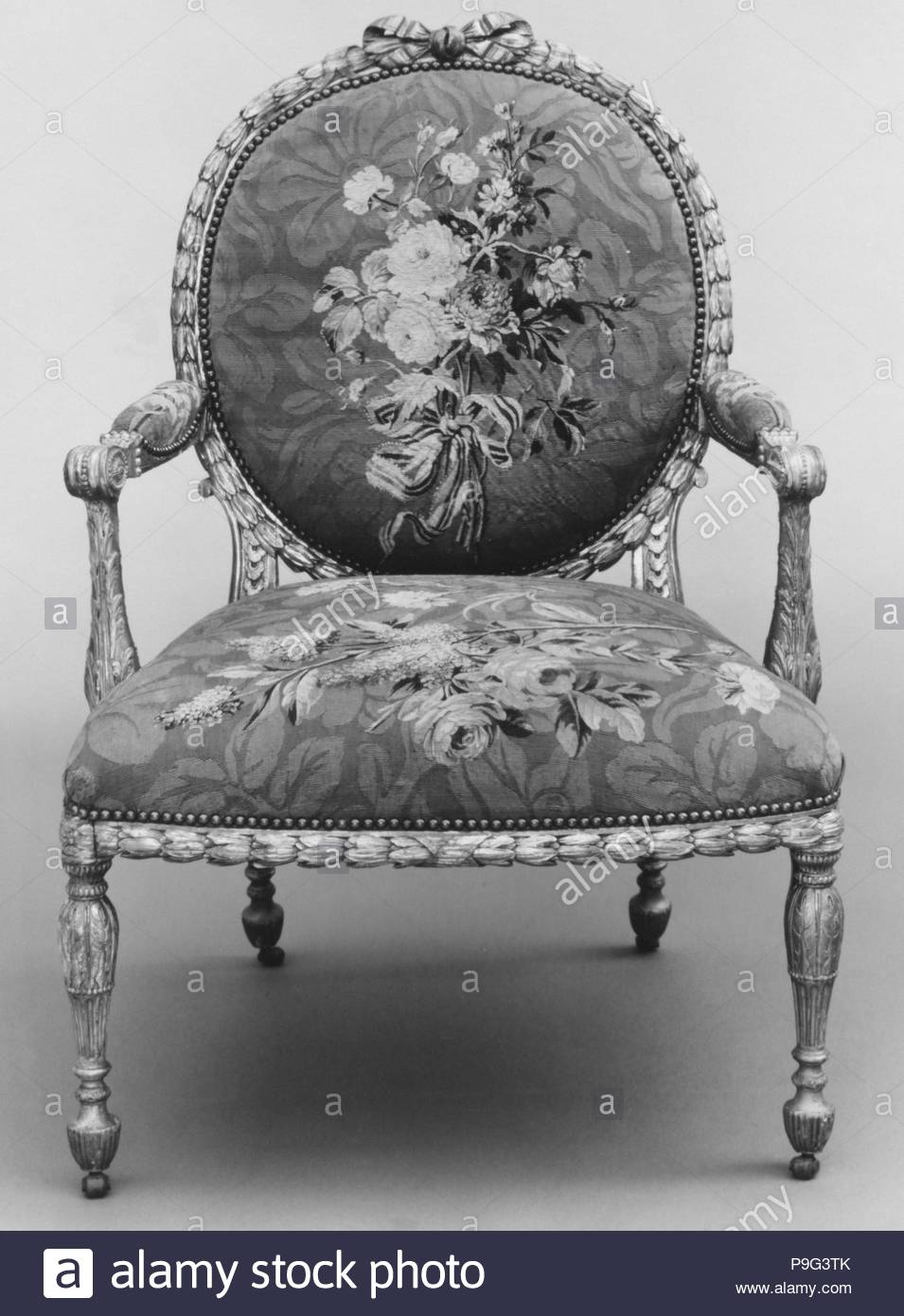 Armchair (one of a set of six), 1769–71, British and French, Gilded fruitwood; wool and silk (22-24 warps per inch, 9-10 per centimeter), 41 5/8 × 28 1/2 × 26 in. (105.7 × 72.4 × 66 cm), Woodwork-Furniture, John Mayhew (British, 1736–1811), and William Ince (British, active ca. 1758/59–1794, died 1804), Workshop of Jacques Neilson (French, 1714–1788). - Stock Image
