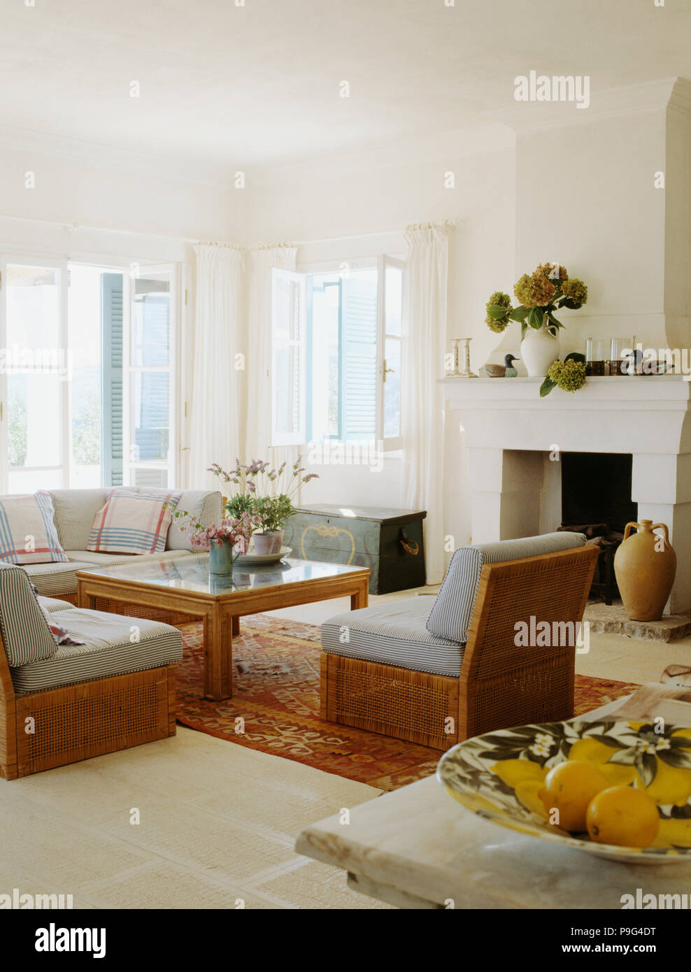 Grey Blue Cushions On Wicker Chairs In White Coastal Living