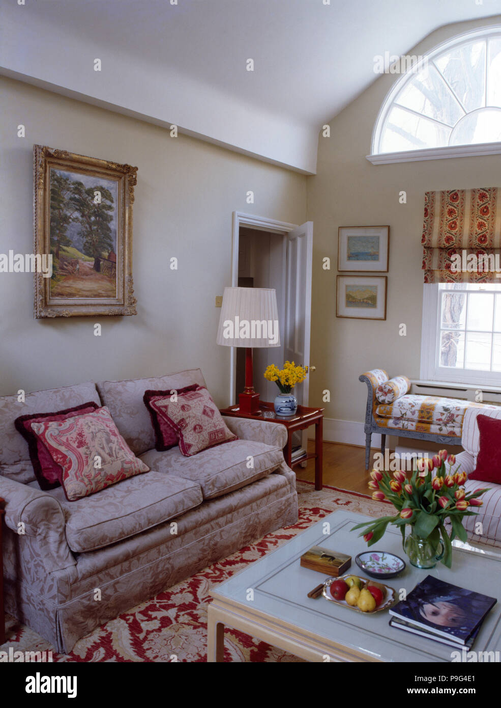 Patterned Cushions On A Neutral Damask Sofa In A Small ...