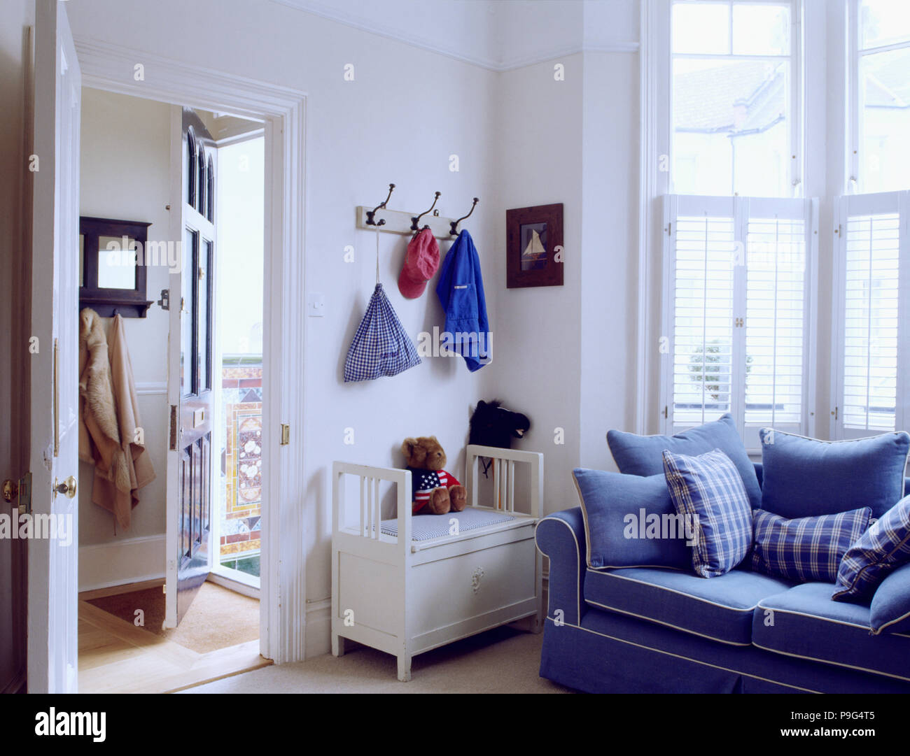 Blue Sofa And White Toys Chest In Family Living Room With
