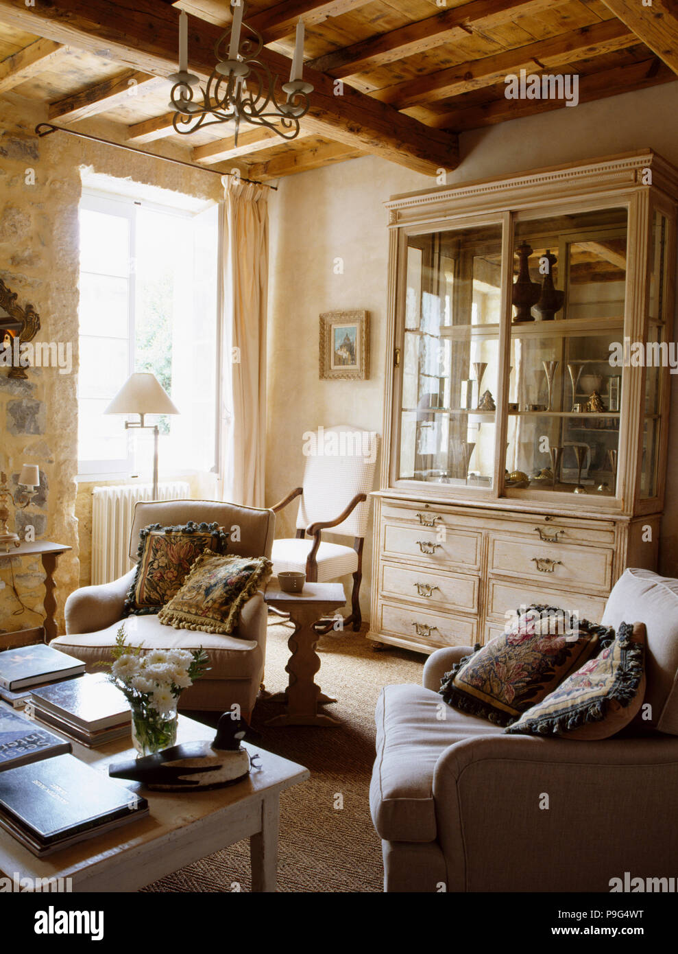 Comfortable armchairs in French country living room with ...