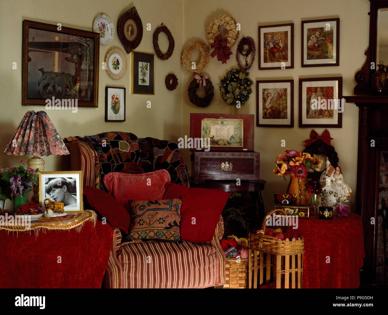 Pictures On Wall In Cluttered Victorian Style Eighties Living Room Stock Photo Alamy