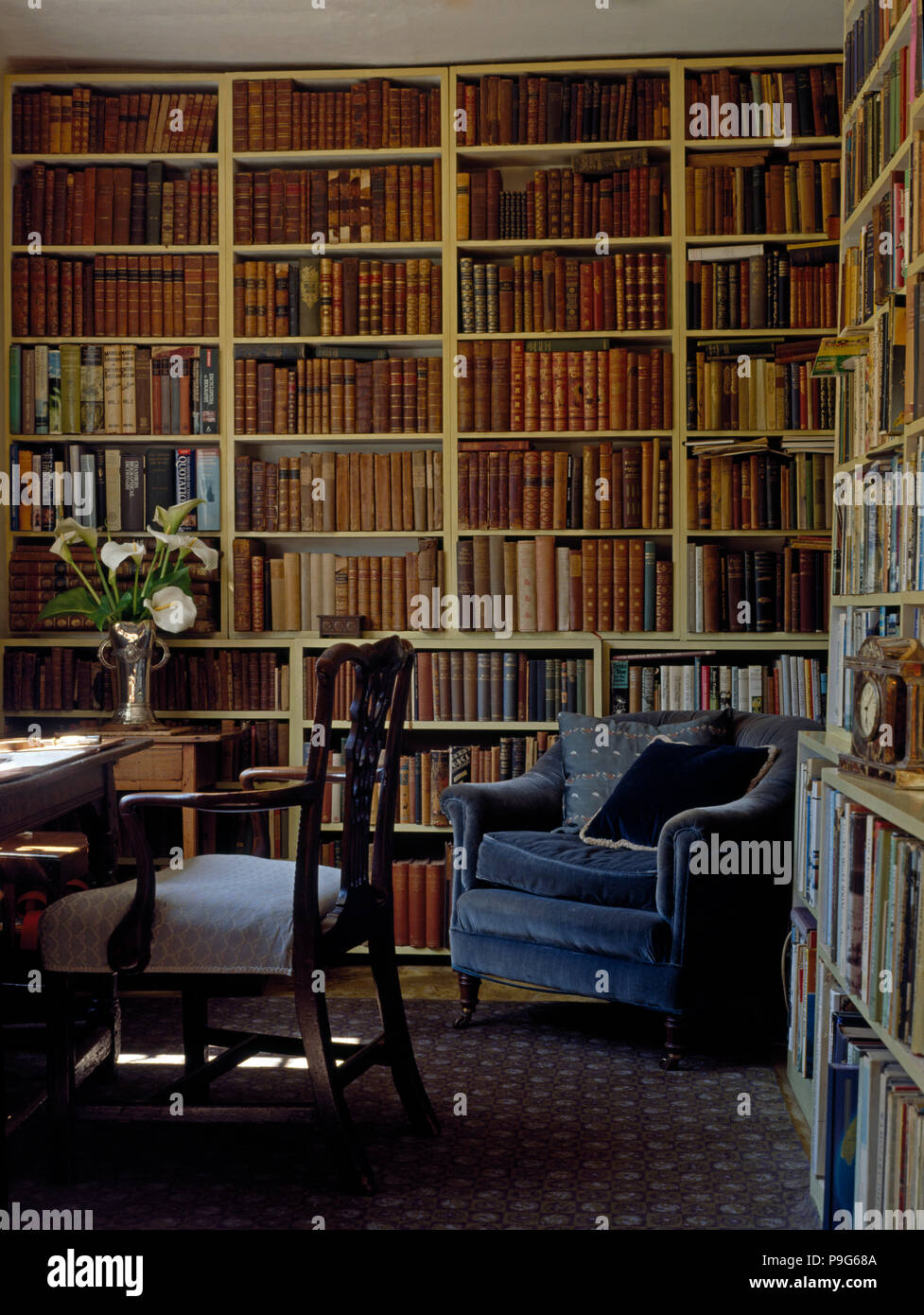 Antique library bookcases Rustic Fitted Bookcases With Antique Leather Bound Books In Country House Study Library With Blue Velvet Armchair Better Homes And Gardens Fitted Bookcases With Antique Leather Bound Books In Country House