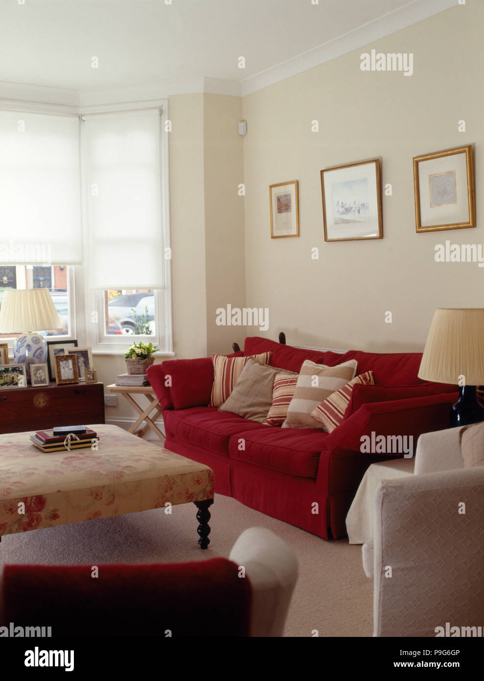 Swell Red Sofa And Floral Patterned Ottoman Stool In A Townhouse Gmtry Best Dining Table And Chair Ideas Images Gmtryco