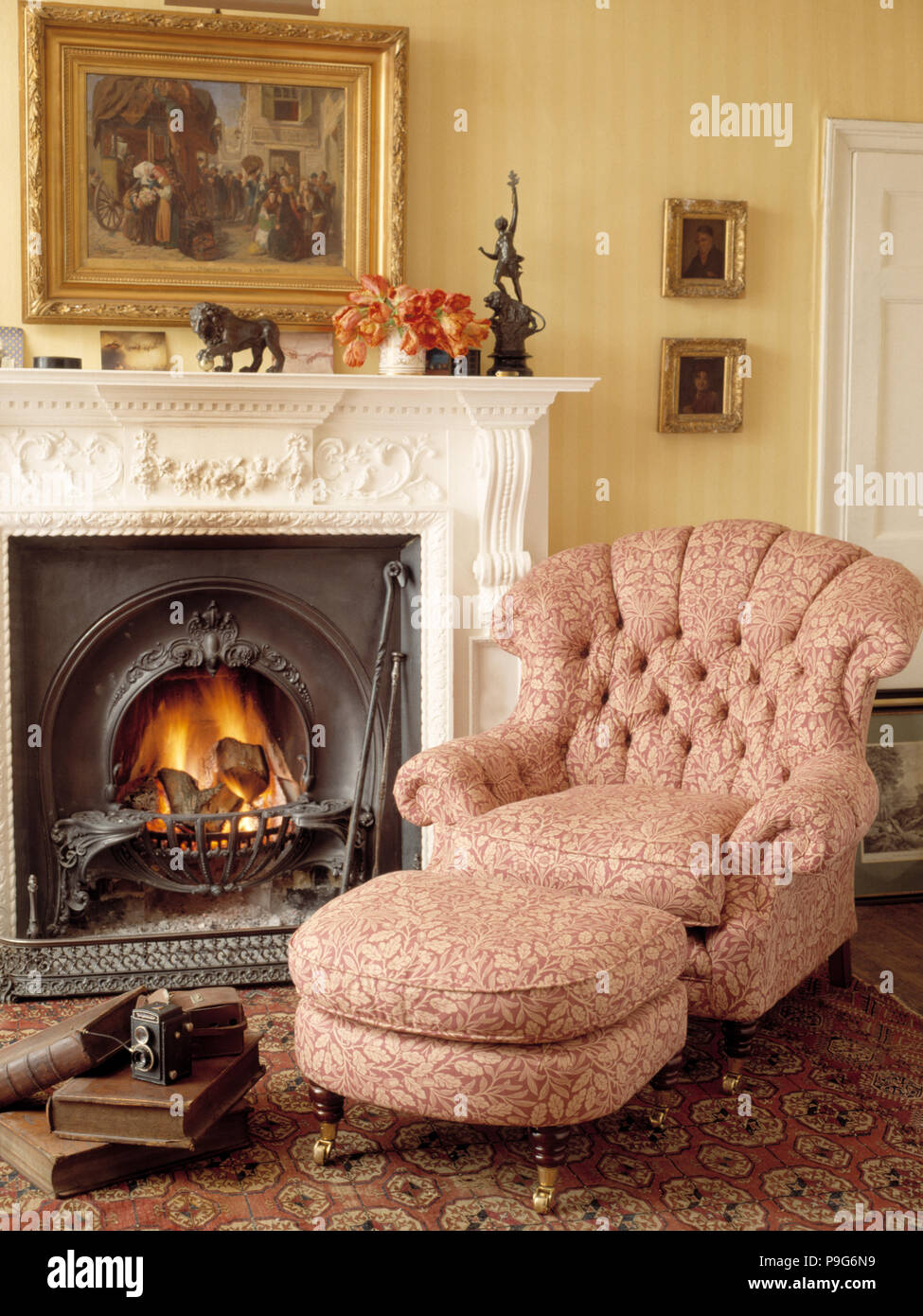 Armchair Beside Fireplace In Traditional Living Room Stock