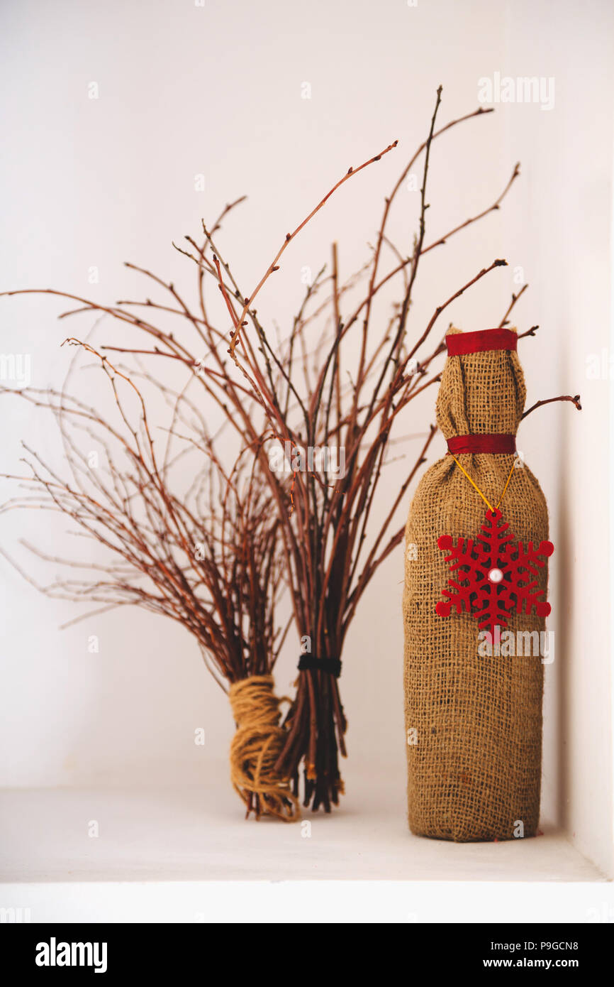 Art Decor Design Dried Branches And Bottle In Textile Cover Stock