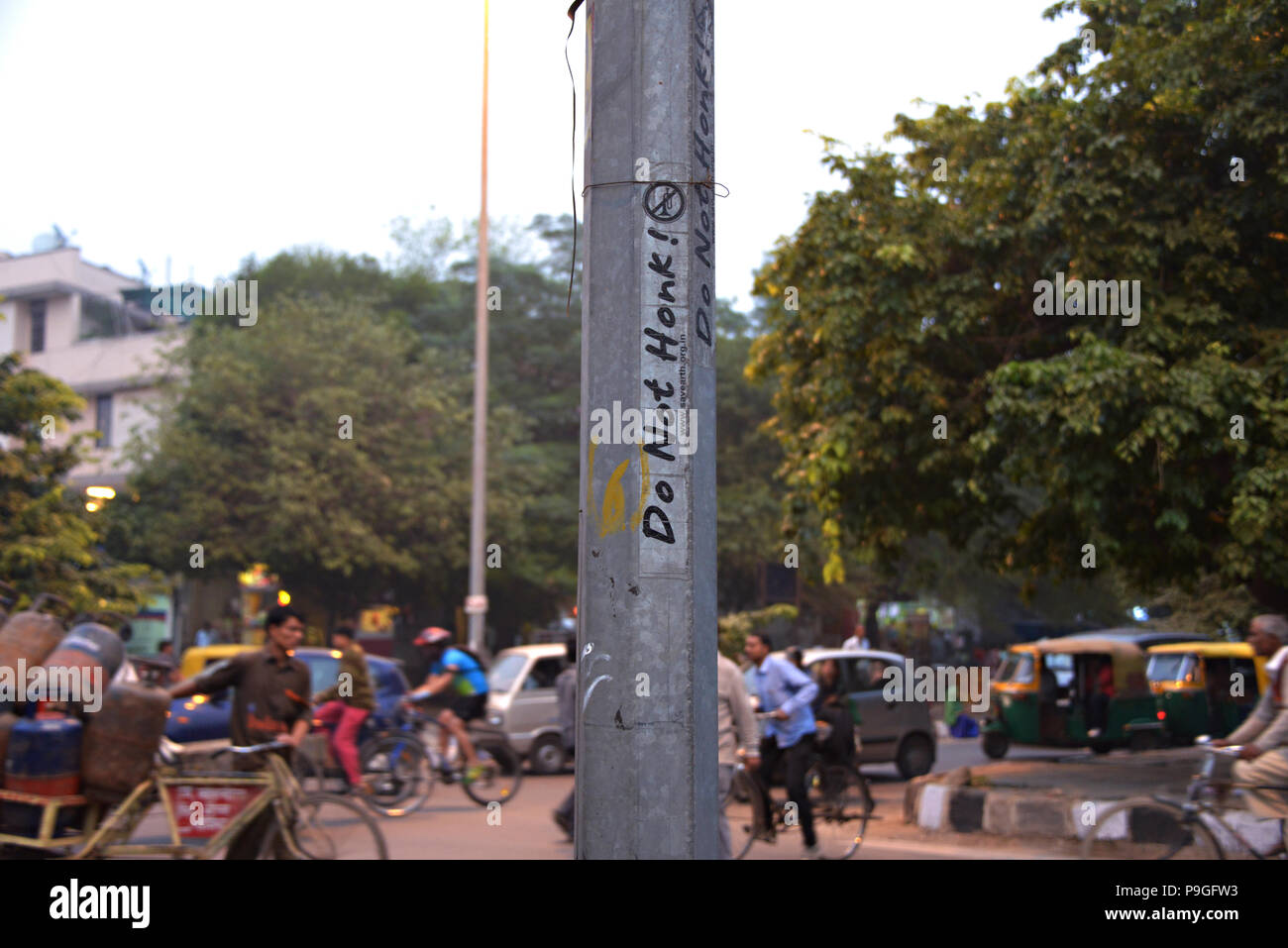 Amusing do not honk sign in Delhi India, photographed from a moving vehicle - Stock Image