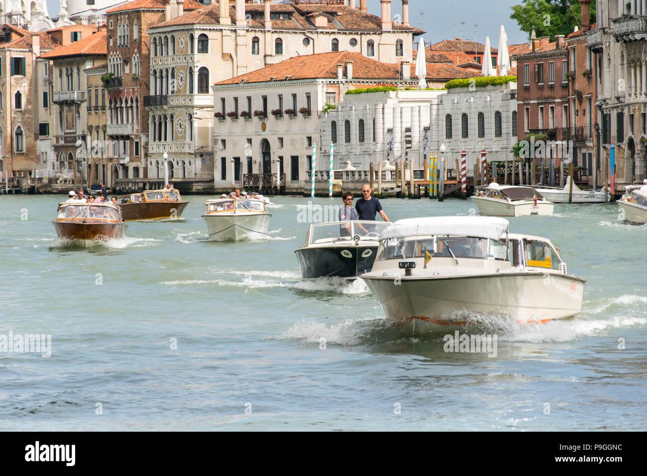 Europe, Italy, Veneto, Venice. Few motorboats swimming on Canale Grande (Grand Canal) in Venice near Ponte dell'Accademia, heading Ponte di Rialto. - Stock Image