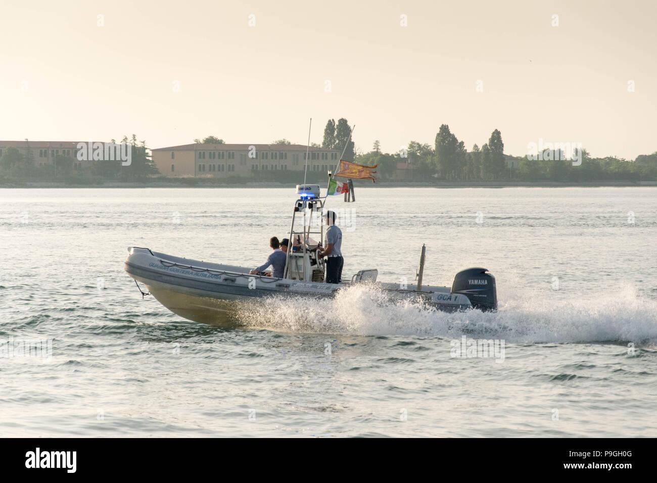 Europe, Italy, Veneto, Venice. Italian Coast Guard (Guardia Costiera) hybrid boat responding with lights and sirens. Lagune di Venezia. - Stock Image