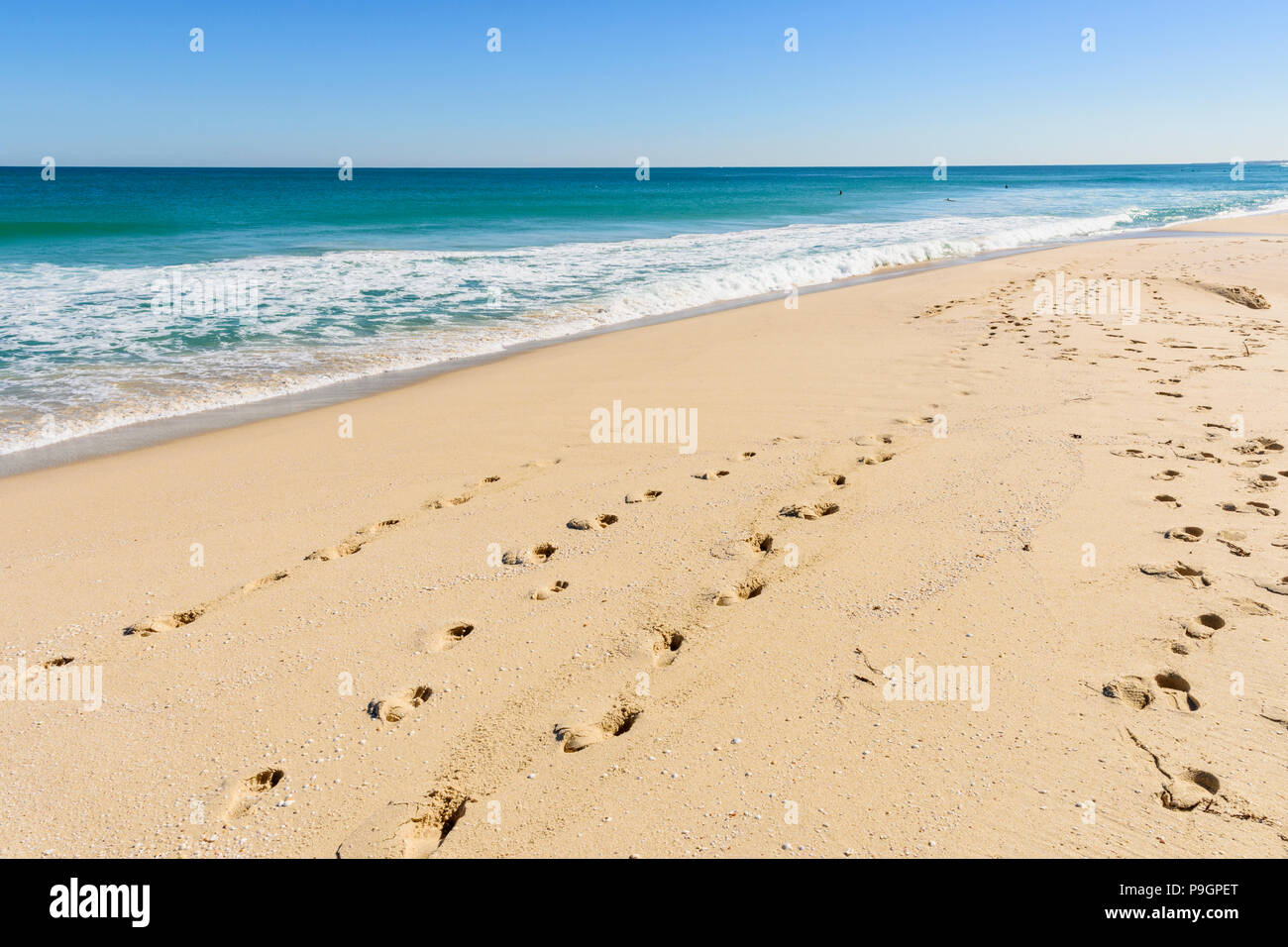 Footprints in the sand at Scarborough Beach, Perth, Western Australia - Stock Image