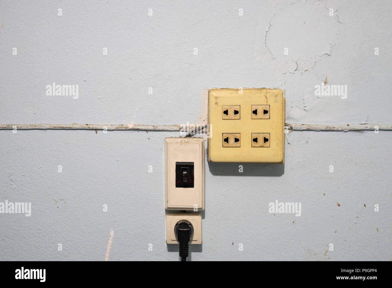 old and dust electricity switches and sockets with wire on grunge ...